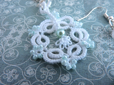 White Lace with Opaque Teal Beads and Moving Pendulum