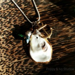 Pendant with shell and beach charms and sparkly glass by Poppy and Ivy Studios. €24http://etsy.me/1Ie7GYL